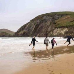 Group walking along the shore, Dingle, Kerry